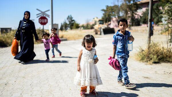 Сирийские беженцы в городе Джераблус, Сирия. Архивное фото