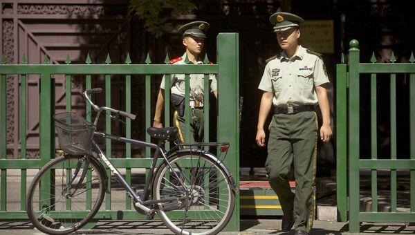 Сотрудники полиции в Китае. Архивное фото