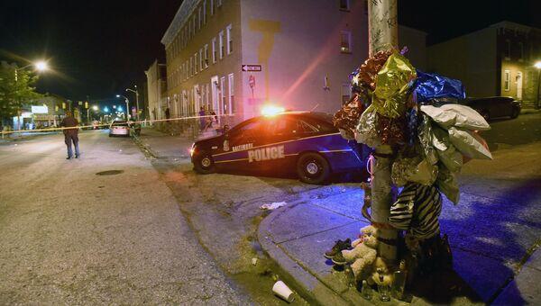 Полицейский автомобиль на месте стрельбы в Балтиморе. 24 сентября 2016