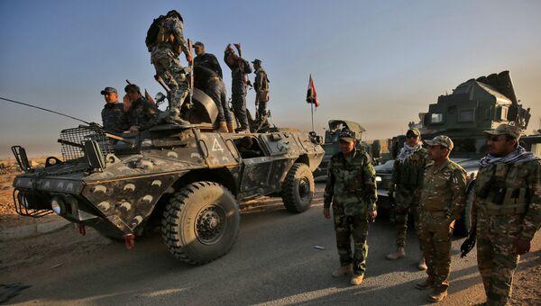 Колонна правительственных сил во время наступления на Мосул в Ираке. Архивное фото