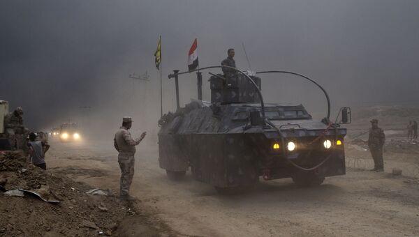 Иракский военный автомобиль в городе Кайяра к югу от Мосула