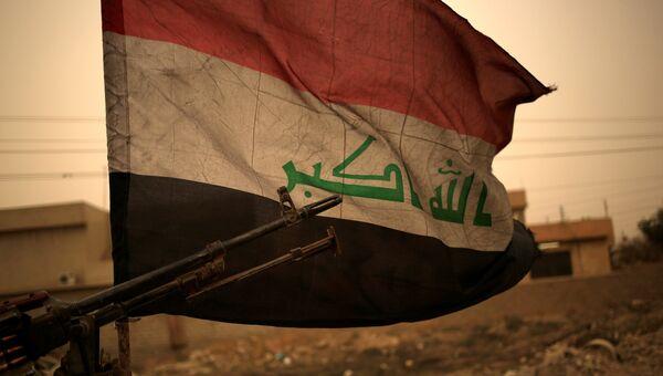 Иракский флаг во время операции против ИГ в Барталле к востоку от Мосула