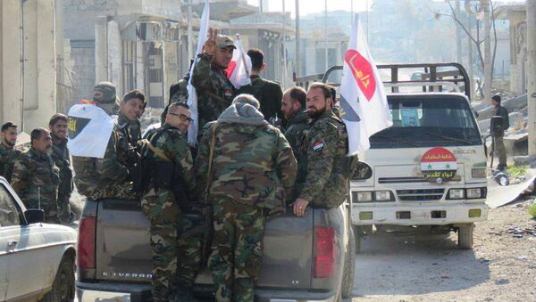 Сирийские военнослужащие в восточном Алеппо