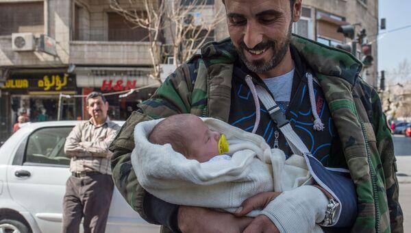 На улице Дамаска в первый день перемирия. Сирия, 27.02.2016