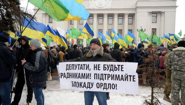 Участник митинга сторонников торговой блокады Донбасса в Киеве. 21 февраля 2017