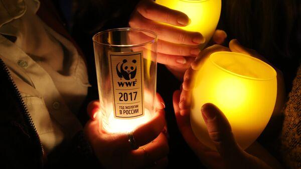 Участники экологической акции Час Земли в Москве