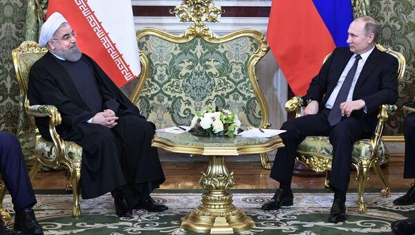 Президент РФ Владимир Путин и президент Исламской Республики Иран Хасан Рухани во время встречи. 28 марта 2017