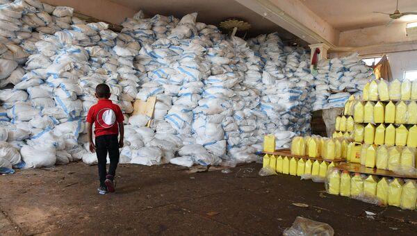 Центр Международного движения Красного Креста и Красного Полумесяца с гуманитарной помощью в сирийском городе Дейр-эз-Зор