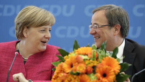 Канцлер Германии Ангела Меркель и основной кандидат ХДС Армин Лашет после объявления результатов голосования на региональных выборах в федеральной земле Северный Рейн-Вестфалия, Германия. 15 мая 2017 года