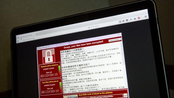 Экран ноутбука с предупреждением об атаке вредоносного вируса в Китае. 13 мая 2017