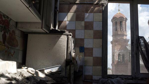 Последствия обстрела поселка Никитовка в Донецкой области. Архивное фото