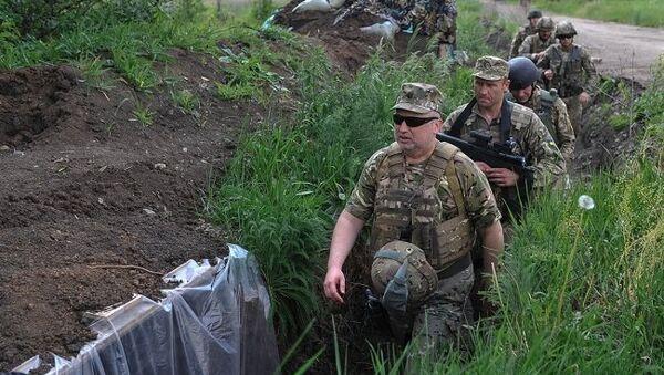 Секретарь Совета национальной безопасности и обороны Украины Александр Турчинов во время визита на Донбасс. 31 мая 2017