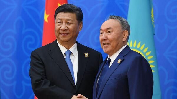 Председатель КНР Си Цзиньпин и президент Казахстана Нурсултан Назарбаев. Архивное фото