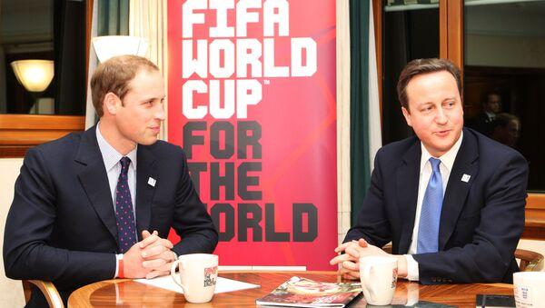 Принц Уильям и премьер-министр Великобритании Дэвид Кэмерон во время встречи в Цюрихе