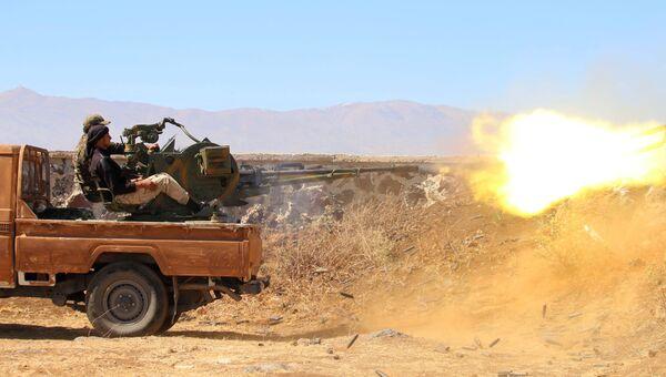 Сирийская оппозиция во время столкновений с правительственными войсками. Архивное фото