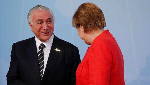Президент Бразилии Мишел Темер и канцлер ФРГ Ангела Меркель в первый день саммита G-20 в Гамбурге