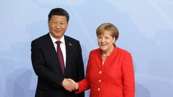 Председатель Китайской Народной Республики Си Цзиньпин и канцлер Германии Ангелой Меркель на саммите G20 в Гамбурге
