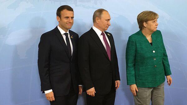 Президент России Владимир Путин, канцлер ФРГ Ангела Меркель и президент Франции Эммануэль Макрон. Архивное фото