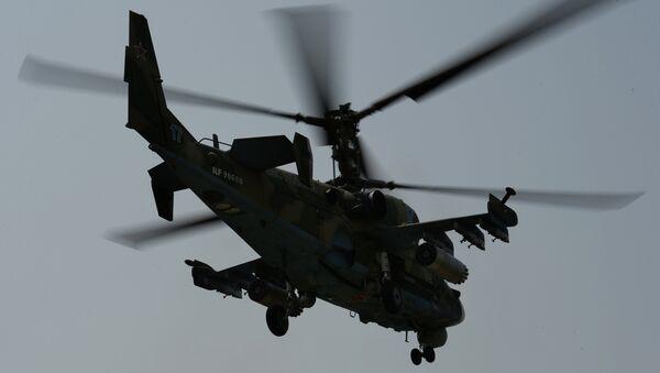 Вертолет Ка-52 Аллигатор во время учений отдельного вертолетного полка на аэродроме Черниговка в Приморском крае
