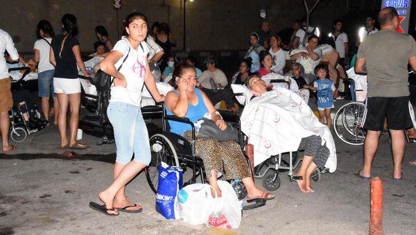 Люди получают медицинскую помощь в больнице в Бодрума, Турция. 21 июля 2017