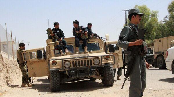 Службы безопасности Афганистана на бронемашине в ходе продолжающейся битвы с боевиками группировки Талибан в районе Гереш провинции Гильменд