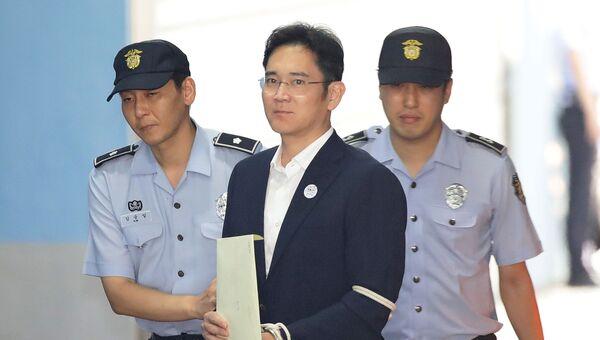 Заместитель председателя правления Samsung Group Ли Чже Ён после судебного заседания в Сеуле. Архивное фото