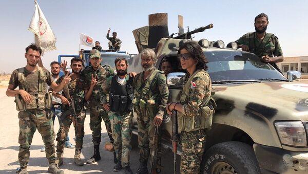 Встреча подразделений пятого корпуса армии САР с частями сирийской армии на юге Дейр-эс-Зора, после прорыва кольца окружения ИГ*. Архивное фото
