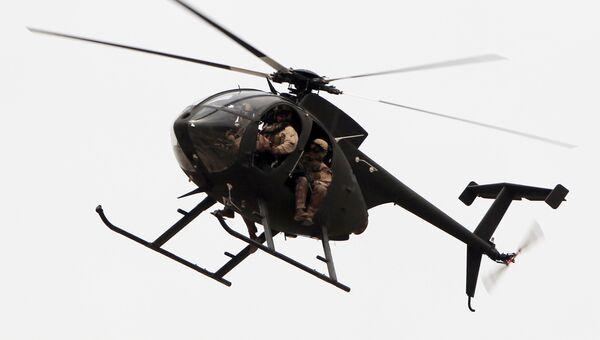 Вертолет частной военной компании DynCorp в Багдаде, Ирак