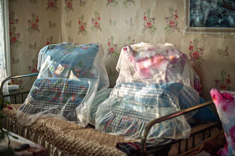 Кровать в доме Шагидэ эби заправлена по старинке
