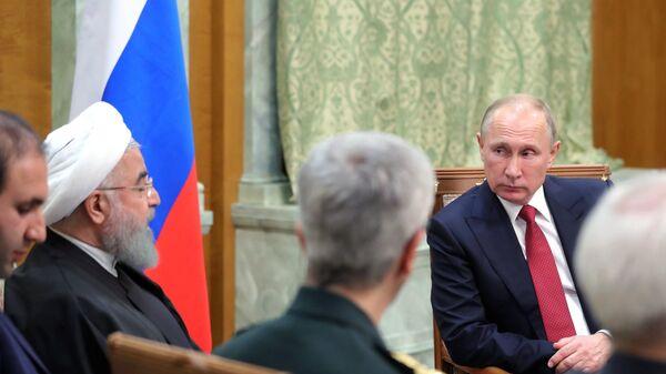 Президент РФ Владимир Путин и президент Ирана Хасан Роухани во время встречи. 22 ноября 2017