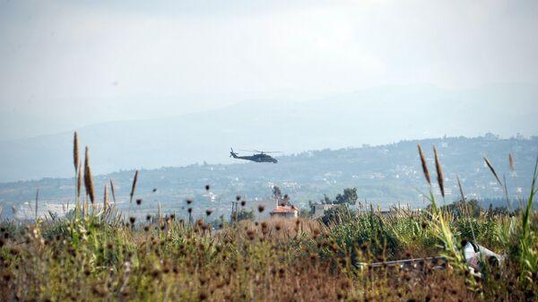 Российский вертолет Ми-24 патрулирует окрестности авиабазы Хмеймим, Сирия