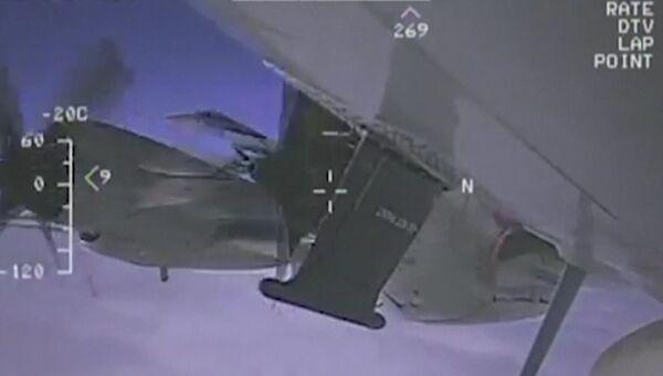 Стоп-кадр видео перехвата американского самолета-разведчика EP-3. Архивное фото
