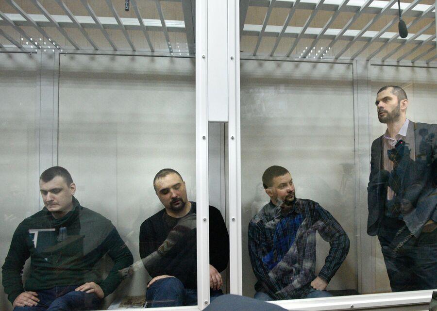 Бывшие бойцы спецподразделения МВД Беркут во время заседания в Святошинском районном суде Киева. 13 февраля 2018