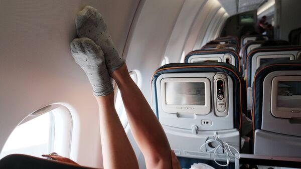 Пассажир в самолете авиакомпании Аэрофлот во время полета