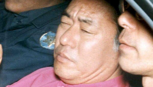 Бывших руководителей АУМ Синрикё* — Киёхидэ Хаякава во время ареста в Токио. Архивное фото