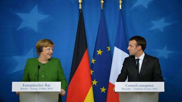 Канцлер Германии Ангела Меркель и президент Франции Эммануэль Макрон на саммите ЕС в Брюсселе. 23 марта 2018