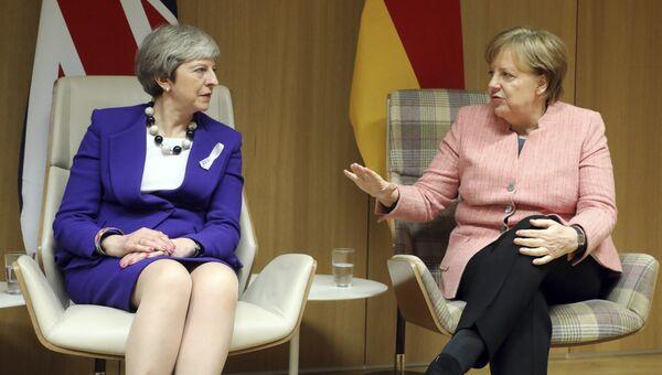 Премьер-министр Великобритании Тереза Мэй и канцлер Германии Ангела Меркель. Архивное фото