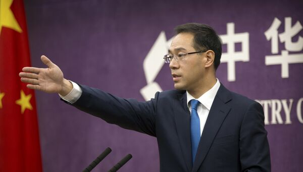 Представитель министерства коммерции КНР Гао Фэн на пресс-конференции в Министерстве торговли в Пекине.  Архивное фото