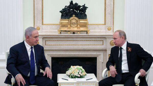 Президент РФ Владимир Путин и премьер-министр государства Израиль Биньямин Нетаньяху во время встречи