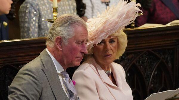 Принц Чарльз с супругой Камиллой во время свадебной церемонии в часовне Св. Георгия в Виндзорском замке недалеко от Лондона, Англия. 19 мая 2018