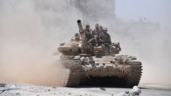 Soldiers of the Syrian army on a T-72 tank in the south of Damascus