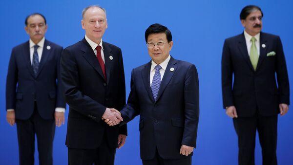 Секретарь Совета безопасности РФ Николай Патрушев и министр общественной безопасности Китая Чжао Кэчжи на встрече секретарей советов безопасности государств-членов ШОС. 22 мая 2018