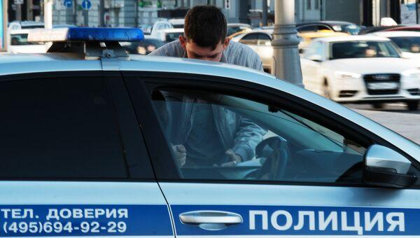 Автомобиль полиции на улице Москвы