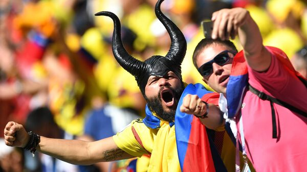 Болельщики сборной Колумбии во время матча группового этапа чемпионата мира по футболу между сборными Колумбии и Японии