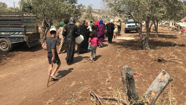 Мирные жители возвращаются в свои дом в провинции Дераа. Архивное фото