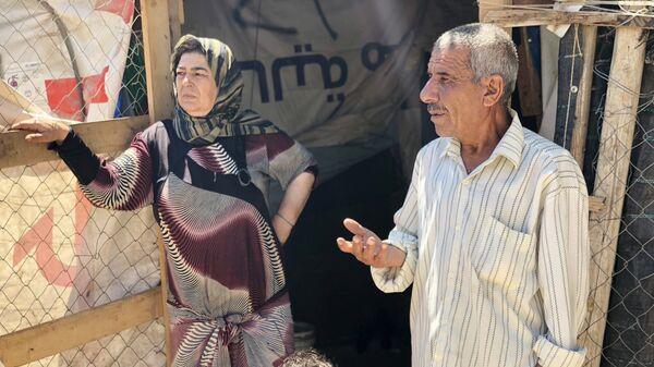 Сирийские беженцы в палаточном лагере в центральном Бекаа в поселении Каб Эльяс. 11 август 2018