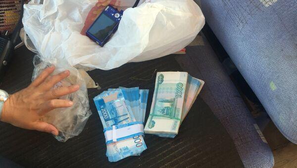 В Урае полицейские задержали мужчину похитившего 400 тысяч рублей в одном из банков. 14 августа 2018