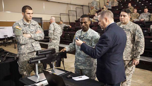 Демонстрация опытного образца комплекса ХМ25 на конференции по оружию, боеприпасам и приборам в Льюис - Маккорд, США. Архивное фото