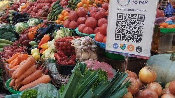 QR-код для оплаты криптовалютой на Бессарабском рынке в Киеве