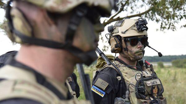 Военнослужащие вооруженных сил Украины и армейских подразделений иностранных государств во время активной фазы военных учений Репид Трайдент - 2018